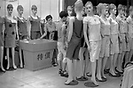 China, Shanghai. In a clothes shop in Nanjing Lu a line of European mannequins stand to attention, not unlike the grave offerings at Xi An.  The large bin contains 'special offers.'  Nanjing Lu is one of the busiest shopping streets in the whole of Asia and Shanghai throughout its history has been celebrated for trade and shopping.  The first department stores in China, Sincere and Wing On, opened in Nanjing Lu in 1919 and one even contained an escalator, much to everyone's delight.