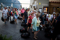 Tourists arrive on Monday, Sept. 21, 2015, on the island of Capri in Italy. (Photo by James Brosher)