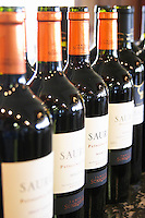 Row of bottles of Saurus Patagonia wine. Bodega Familia Schroeder Winery, also called Saurus, Neuquen, Patagonia, Argentina, South America