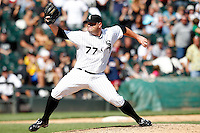 Chicago White Sox relief pitcher Will Ohman #77 delivers a pitch during a game against the Kansas City Royals at U.S. Cellular Field on August 14, 2011 in Chicago, Illinois.  Chicago defeated Kansas City 6-2.  (Mike Janes/Four Seam Images)