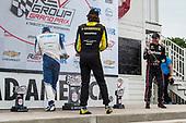Second Place #26: Colton Herta, Andretti Autosport Honda , Race Winner #10: Alex Palou, Chip Ganassi Racing Honda,  and Third Place #12: Will Power, Team Penske Chevrolet