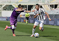 Cristiano Ronaldo of Juventus  and Martin Caceres of Fiorentina during the  italian serie a soccer match,Fiorentina - Juventus at  theStadio Franchi in  Florence Italy ,