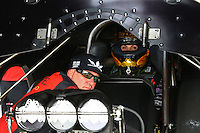 May 15, 2015; Commerce, GA, USA; NHRA funny car driver Alexis DeJoria (right) sits strapped into her car alongside husband Jesse James during qualifying for the Southern Nationals at Atlanta Dragway. Mandatory Credit: Mark J. Rebilas-USA TODAY Sports
