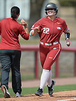 Arkansas outfielder Linnie Malkin is congratulated Saturday, Oct. 9, 2021, by coach Courtney Deifel after hitting a home run during play against Butler Community College at Bogle Park in Fayetteville. Visit nwaonline.com/211010Daily/ for today's photo gallery.<br /> (NWA Democrat-Gazette/Andy Shupe)