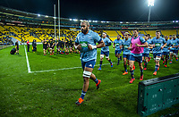 Blues captain Patrick Tuipulotu leads his team in from their warmup during the Super Rugby Aotearoa match between the Hurricanes and Blues at Sky Stadium in Wellington, New Zealand on Saturday, 18 July 2020. Photo: Dave Lintott / lintottphoto.co.nz