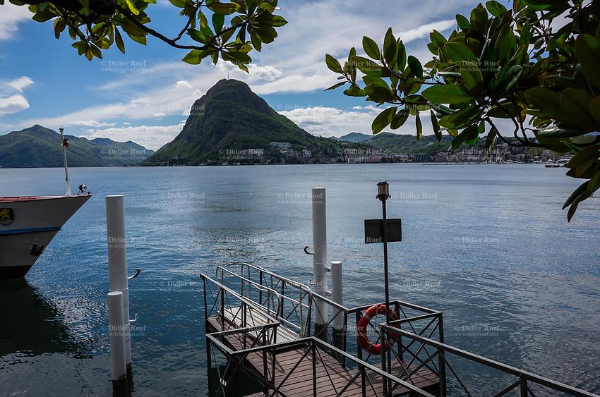 Switzerland. Canton Ticino. Lugano. Tourist boat's landing stage. View on Lake Lugano and the Monte San Salvatore. Lake Lugano (Italian: Lago di Lugano or Ceresio) is a glacial lake. The Monte San Salvatore (912 m) is a mountain in the Lepontine Alps above Lake Lugano and the city of Lugano. 28.04.2019 © 2019 Didier Ruef