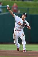 Springfield Cardinals shortstop Greg Miclat (3) throws to first during a game against the Frisco Rough Riders on June 1, 2014 at Hammons Field in Springfield, Missouri.  Springfield defeated Frisco 3-2.  (Mike Janes/Four Seam Images)