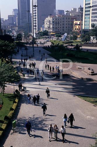 Sao Paulo, Brazil. Pedestrians walking in the Vale do Anhangabau city centre park.