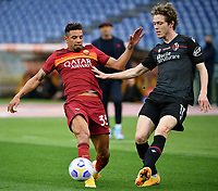 Football, Serie A: AS Roma - Bologna, Olympic stadium, Rome, April 11, 2021. <br /> Roma's Bruno Peres (l) in action with Bologna's Andreas Skov Olsen (r) during the Italian Serie A football match between AS Roma and Bologna at Rome's Olympic stadium, Rome, on April 11, 2021.  <br /> UPDATE IMAGES PRESS/Isabella Bonotto
