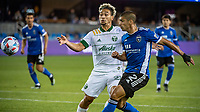 SAN JOSE, CA - MAY 15: Pablo Bonilla #28 of the Portland Timbers challenges Luciano Abecasis #2 of the San Jose Earthquakes during a game between San Jose Earthquakes and Portland Timbers at PayPal Park on May 15, 2021 in San Jose, California.