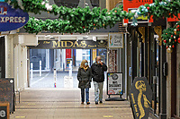Pictured: Shoppers wearing facemasks in an arcade off Oxford Street, in the city centre of Swansea, Wales, UK. Monday 30 November 2020<br /> Re: Pubs and restaurants will have to stop serving alcohol shut at 6pm from this Friday due to the Covid-19 Coronavirus pandemic, Wales, UK.