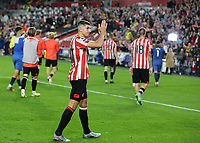Vitaly Janelt of Brentford applauds the home fans at the end of the match during Brentford vs Liverpool, Premier League Football at the Brentford Community Stadium on 25th September 2021