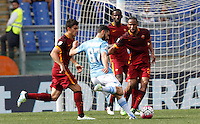 Calcio, Serie A: Lazio vs Roma. Roma, stadio Olimpico, 3 aprile 2016.<br /> Lazio's Antonio Candreva, third from right, kicks the ball during the Italian Serie A football match between Lazio and Roma at Rome's Olympic stadium, 3 April 2016.<br /> UPDATE IMAGES PRESS/Riccardo De Luca