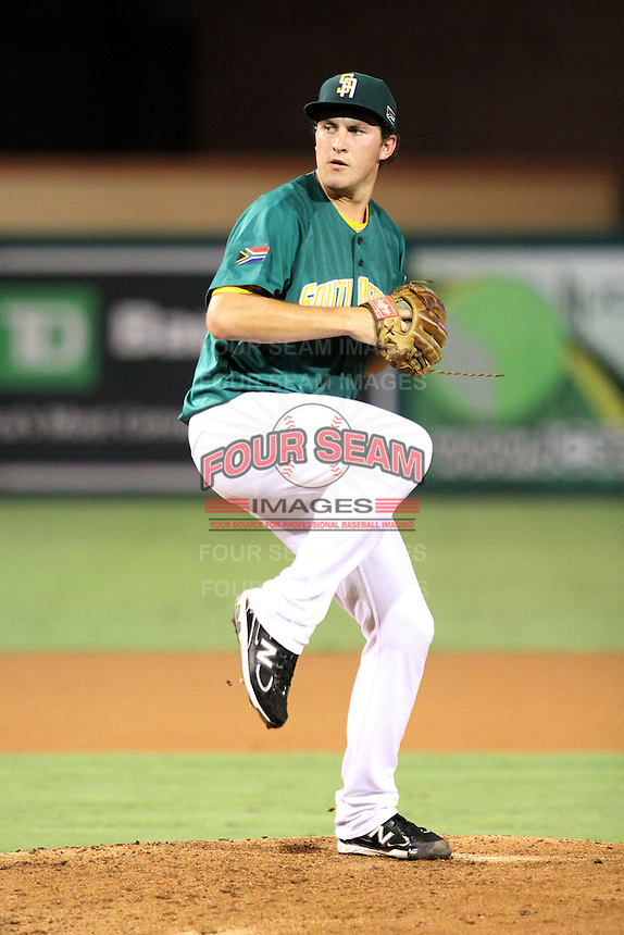 Hein Robb #27 of Team South Africa pitches during a game against Team Israel at Roger Dean Stadium on September 19, 2012 in Jupiter, Florida. Team Israel defeated Team South Africa 7-3.  (Stacy Jo Grant/Four Seam Images).