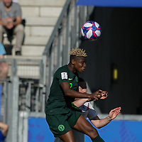 GRENOBLE, FRANCE - JUNE 22: Uchenna Kanu #12 of the Nigerian National Team, Marina Hegering #5 of the German National Team battle for head ball during a game between Nigeria and Germany at Stade des Alpes on June 22, 2019 in Grenoble, France.