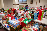 WATERBURY, CT. 21 December 2019-122119BS298 - Gifts donated by parishioners fill a room which will be given out to each individual in attendance, during a Christmas Party for the less fortunate and homeless at the Basilica of Immaculate Conception in Waterbury on Saturday. Bill Shettle Republican-American