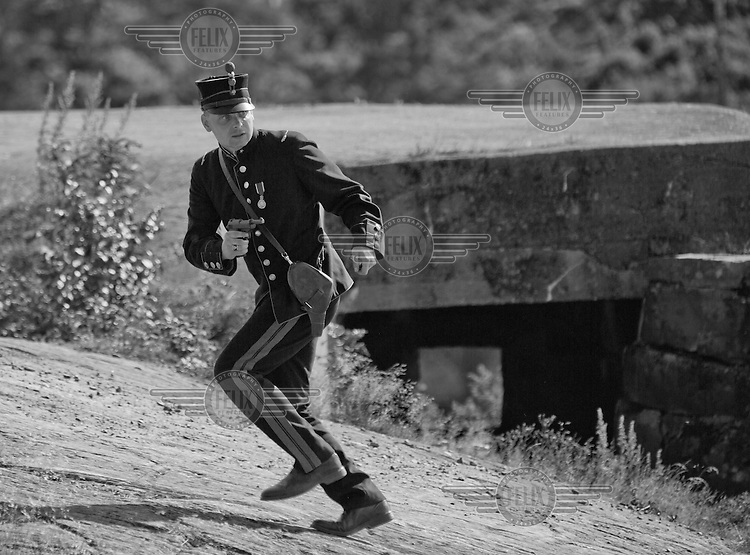 Areenacort playing the part of a Norwegian soldier 1940 flee advancing German troops.<br /> <br /> Airplanes and reenactors photographed at in connection with Høytorptreffet, an annual event at the Høytorp fort. <br /> <br /> Høytorp fort is a barrage fort in the Glomma defence line, built 1912-17. On April 13th and 14th 1940 the fort was in combat against German army units . It is now protected as a national monument.<br /> <br /> ©Fredrik Naumann/Felix Features