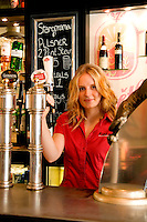 Barmaid at the PIVO Cafe Pub on Corn Exchange Street in Stirling, Scotland