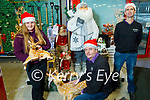 Staff in Brownes in Castleisland on Monday getting ready for Christmas. Kneeling: Tom Scanlon. Standing: Linda Scanlon and Ger McGuire.