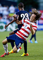 PORTLAND, Ore. - July 9, 2013: Mix Diskerud is fouled in the first half. The US Men's National team plays the National team of Belize during the 2013 Gold Cup at at JELD-WEN Field.
