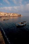 Crete, Greece, Chania, Khania (Greek sp), Inner harbor seawall and old town, Mediterranean Sea,