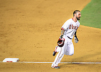 Jun. 8, 2012; Phoenix, AZ, USA; Arizona Diamondbacks third baseman Ryan Roberts celebrates as he rounds the bases after hitting a three run walk off home run in the ninth inning against the Oakland Athletics at Chase Field.  Mandatory Credit: Mark J. Rebilas-