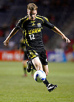 Columbus Crew midfielder Eddie Gaven (12) goes airborne to receive the ball.  The Chicago Fire tied the Columbus Crew 0-0 at Toyota Park in Bridgeview, IL on July 29, 2006.