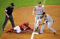 May 10, 2009; Phoenix, AZ, USA; Arizona Diamondbacks base runner Justin Upton slides safely into third base with a stolen base in the third inning ahead of the tag by Washington Nationals infielder Alex Cintron at Chase Field. Mandatory Credit: Mark J. Rebilas-