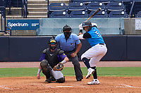 Tampa Tarpons batter Carlos Narvaez (5) awaits the pitch along with catcher Kyle Schmidt (37) and umpire Rainiero Valero during a game against the Fort Myers Mighty Mussels on May 23, 2021 at George M. Steinbrenner Field in Tampa, Florida.  (Mike Janes/Four Seam Images)