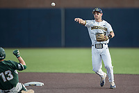 Michigan Wolverines shortstop Michael Brdar (9) turns a double play against the Michigan State Spartans during the NCAA baseball game on April 18, 2017 at Ray Fisher Stadium in Ann Arbor, Michigan. Michigan defeated Michigan State 12-4. (Andrew Woolley/Four Seam Images)