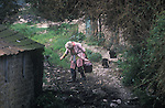 Helen Parfitt feeding the cats. Parfitt Sisters Story, Spargrove Manor, Batcombe, Somerset. Taken for the Sunday Times Magazine 1988. Used December 1988.