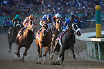 9 April 2009: Zenyatta (far left), riden by Mike Smith, dropped back 6 lengths at the start before winning the 45th running of the Apple Blossom at Oaklawn in Hot Springs, Arkansas