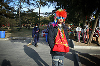 CHINA. A man during Chinese New Year in Ditan Park in Beijing.  Chinese New Year, or Spring Festival, is the most important festival and holiday in the Chinese calendar In mainland China, many people use this holiday to visit family and friends and also visit local temples to offer prayers to their ancestors. The roots of Chinese New Year lie in combined influences from Buddhism, Taoism, Confucianism, and folk religions.  2008