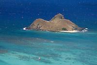 Sailboat and kayak near North Mokulua Island off the coasts of Lanikai and Kailua