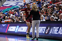 GREENSBORO, NC - MARCH 07: Marnelle Garraud #14 of Boston College is embraced by head coach Joanna Bernabei-McNamee after fouling out during a game between Boston College and NC State at Greensboro Coliseum on March 07, 2020 in Greensboro, North Carolina.