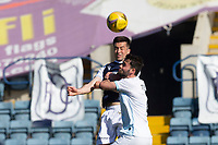 24th April 2021; Dens Park, Dundee, Scotland; Scottish Championship Football, Dundee FC versus Raith Rovers; Cammy Kerr of Dundee heads clear from Reghan Tumilty of Raith Rovers