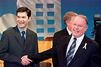 March 31 2003, Montreal, Quebec, Canada<br /> <br /> Bernard Landry, Quebec Premier and Leader of the Parti Quebecois (R) shake hands  talk with <br /> Mario Dumont, Leader of  Quebec Democratic Action<br />  (Action DÈmocratique du QuÈbec) (L) <br /> before  the Televised debate between leaders , March 31 2003 in Montreal, Canada.<br /> <br /> Quebec elections will be held April 14, 2003<br /> <br /> Mandatory Credit: Photo by  Steeve Duguay- Images Distribution. (©) Copyright 2003 by Steeve Duguay<br /> <br /> NOTE : <br />  Nikon D-1 jpeg opened with Qimage icc profile, saved in Adobe 1998 RGB<br /> .Uncompressed  Original  size  file availble on request.