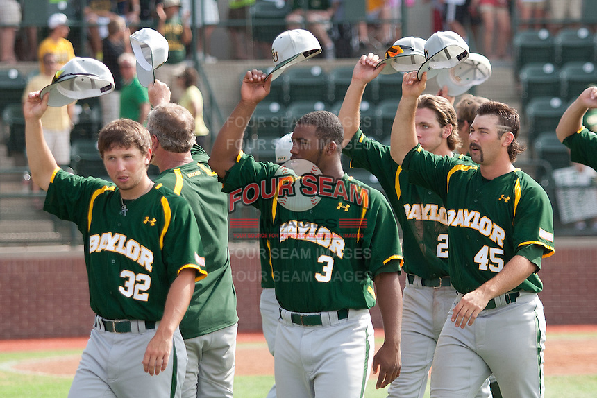 Baylor Bears baseball players Josh Turley #32, Trae Davis #3, Kolt Browder #45 tip their caps to the home crowd after the NCAA Regional baseball game against Oral Roberts University on June 3, 2012 at Baylor Ball Park in Waco, Texas. Baylor defeated Oral Roberts 5-2. (Andrew Woolley/Four Seam Images)