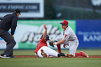 Lakewood BlueClaws shortstop Nick Maton (6) follows through on his tag of Tate Blackman (20) of the Kannapolis Intimidators as he attempts to steal second base at Kannapolis Intimidators Stadium on April 6, 2018 in Kannapolis, North Carolina.  The BlueClaws defeated the Intimidators 4-3. (Brian Westerholt/Four Seam Images)