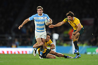 Santiago Cordero of Argentina is tackled by Matt Toomua of Australia as Nick Phipps of Australia supports during the Semi Final of the Rugby World Cup 2015 between Argentina and Australia - 25/10/2015 - Twickenham Stadium, London<br /> Mandatory Credit: Rob Munro/Stewart Communications