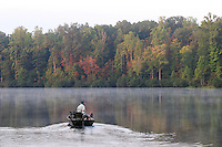 A man goes fishing on a lake in Albemarle County, VA.