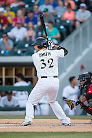 Kevan Smith (32) of the Charlotte Knights at bat against the Indianapolis Indians at BB&T BallPark on June 20, 2015 in Charlotte, North Carolina.  The Knights defeated the Indians 6-5 in 12 innings.  (Brian Westerholt/Four Seam Images)