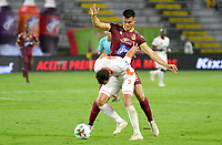 IBAGUE - COLOMBIA, 07-02-2020: Francisco Rodriguez del Tolima disputa el balón con Francisco Baez del Envigado durante partido entre Deportes Tolima y Envigado F.C. por la fecha 4 de la Liga BetPlay I 2020 jugado en el estadio Manuel Murillo Toro de la ciudad de Ibagué. / Francisco Rodriguez of Tolima struggles the ball with Francisco Baez of Envigado during match between Deportes Tolima and Envigado F.C. for the date 4 as part of BetPlay League I 2020 played at Manuel Murillo Toro stadium in Ibague. Photo: VizzorImage / Juan Carlos Escobar / Cont