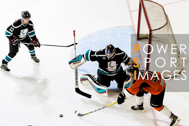Cathay Flyers Goalie Jasen Await (C) makes a save on Whitney Olsen of HK Tigers (R) during the Mega Ice Hockey 5s match between Cathay Flyers and HK Tigers on May 04, 2018 in Hong Kong, Hong Kong. Photo by Marcio Rodrigo Machado / Power Sport Images