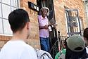Homeowner Doris Early greets Tulane freshmen volunteers with South Seventh Ward Neighbors, 2016.