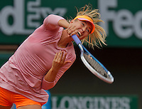 France, Paris, 26.05.2014. Tennis, Roland Garros,  Maria Sharapova (RUS) serving in her match  against Ksenia Pervak (RUS)<br /> Photo:Tennisimages/Henk Koster