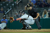 Winston-Salem Dash catcher Winston-Salem Dash Evan Skoug (19) sets a target as home plate umpire Jake Bruner looks on during the game against the Myrtle Beach Pelicans at TicketReturn.com Field on May 16, 2019 in Myrtle Beach, South Carolina. The Dash defeated the Pelicans 6-0. (Brian Westerholt/Four Seam Images)