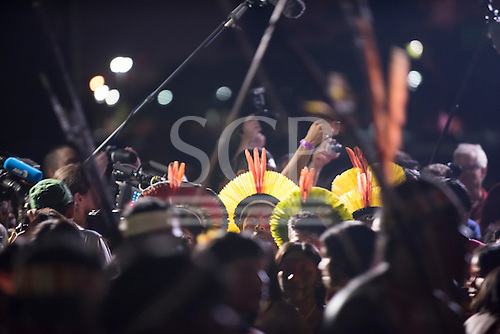 Kayapo indigenous warriors look lost in a sea of cameras and microphones at the Fire Ceremony to launch the first ever International Indigenous Games, in the city of Palmas, Tocantins State, Brazil. Photo © Sue Cunningham, pictures@scphotographic.com 22nd October 2015