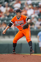 Oklahoma State Cowboys starting pitcher Tyler Buffett #37 winds up to deliver a pitch during the NCAA baseball game against the Texas Longhorns on April 26, 2014 at UFCU Disch–Falk Field in Austin, Texas. The Cowboys defeated the Longhorns 2-1. (Andrew Woolley/Four Seam Images)