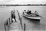 Bob Cross the ferryman rowing travellers from Southwold across the river Blyth to Walberswick Suffolk. UK. 1984.